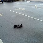 lost shoes in car park by H J Field