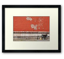 A Tricycle and Two Brooms Framed Print