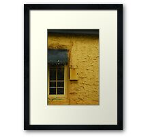 Yellow wall black window Framed Print