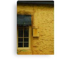 Yellow wall black window Canvas Print
