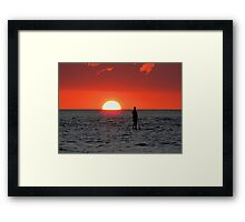 One step away from the setting sun. Framed Print