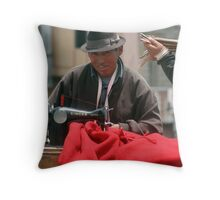 Man sewing, Quilitoa Throw Pillow