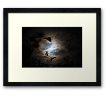 The Moon Behind Clouds Framed Print
