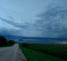 Ominous Clouds Over Country Road by Christopher Hanke