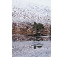 An island with trees on a partially frozen Loch Ossian Photographic Print