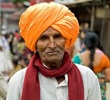 A walking man with the traditional turban over his head by neneaniket