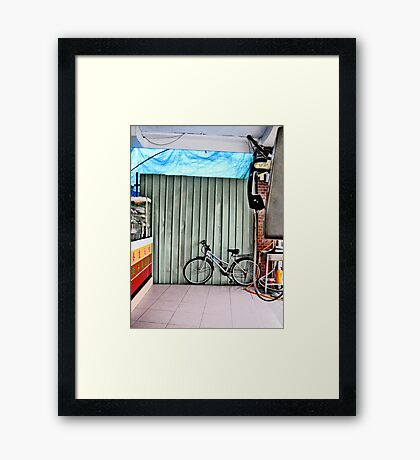 Coin Phone Bike Framed Print