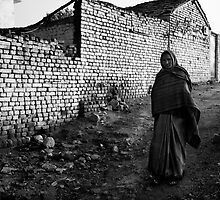 Woman Walking Against a White Wall by Mark Smart