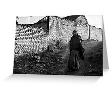 Woman Walking Against a White Wall Greeting Card