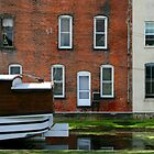 Canal Boat in Water by Michael  Herrfurth