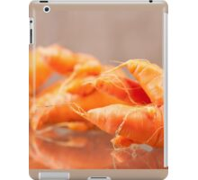 Fresh deformed carrot roots iPad Case/Skin