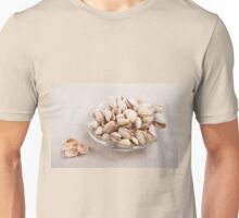 pistachio nuts in shell lying Unisex T-Shirt