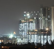 Kota Kasablanka (under construction, by night) by buildings
