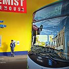 Streets and travellers by Adrian Donoghue