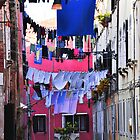 Hanging laundry in Venice by Ingrida Sokolovaite