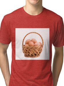eggs in wicker basket  Tri-blend T-Shirt