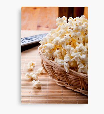 basket full of many crunchy popcorn Canvas Print