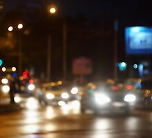 Abstract blurred image of a night scene with bright lights by vladromensky