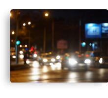 Abstract blurred image of a night scene with bright lights Canvas Print