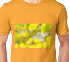 Spring green leaves and blurred space Unisex T-Shirt
