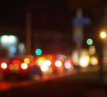 Abstract blur image of a night scene with bright lights by vladromensky