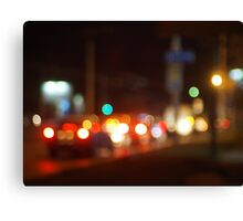Abstract blur image of a night scene with bright lights Canvas Print