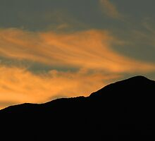Wisps of Clouds Over a Mountain by rhamm