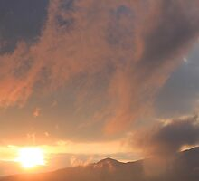 Colorful Clouds Over Mountains by rhamm