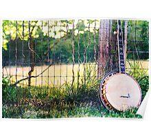 Vintage Banjo against barn fence Poster