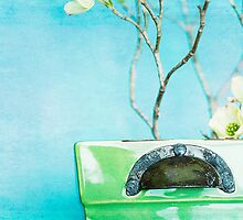 Early spring dogwood branches in green vase. by Jennifer Westmoreland