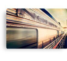 Silver train speeding past. Canvas Print