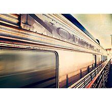 Silver train speeding past. Photographic Print