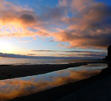 Sunrise Reflection in a tidal pool. by suzannenz