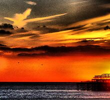 sunset over pier by Janis Read-Walters