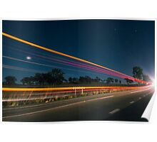 Light trails at night with flare Poster