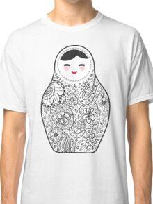 Cute doll matrioshka Babushka on black background Classic T-Shirt