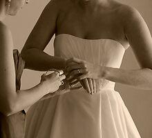 Bride Putting on Bracelets on Wedding Day by thebaum