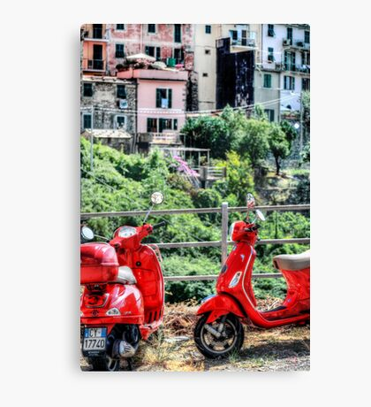 2 Red Scooters Canvas Print