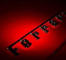 FERRARI LOGO ON A RED FERRARI by Daniel  Oyvetsky