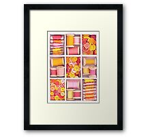 Collection of yellow, red, pink spools  threads on in a white wooden box Framed Print