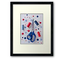 Sewing kit on a wooden table Framed Print