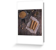 Homemade waffles with waffle iron on wooden table Greeting Card