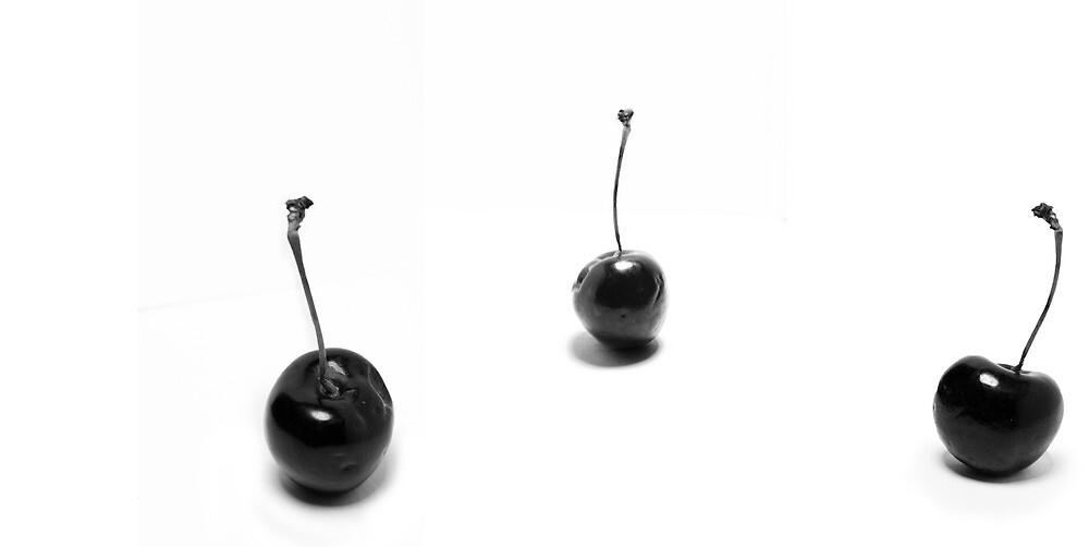 3 black cherries by Michael Mavor