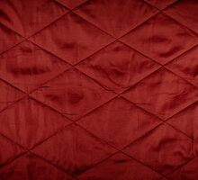 Red quilted material texture abstract by Arletta Cwalina