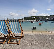 Deck chairs overlooking St. Ives harbour by capelston