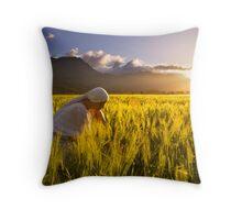 Girl in a golden field Throw Pillow