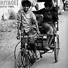 Boys playing on rickshaw  by Mark Smart