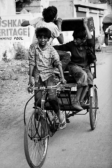 Boys playing on rickshaw  by Mark Smart