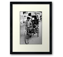 Boys playing on rickshaw  Framed Print