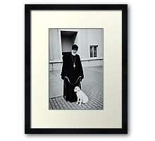 The Bishop and his Dog Framed Print
